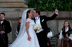 59793566<br /> The newly wed Swedish Princess Madeleine and U.S. banker Christopher O Neill kiss outside the Royal Chapel after their wedding ceremony in Stockholm, Sweden, on June 8, 2013. UK ONLY