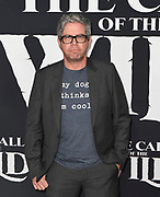 """13 February 2020 - Hollywood, California - John Powell at the World Premiere of twentieth Century Studios """"The Call of the Wild"""" Red Carpet Arrivals at the El Capitan Theater."""