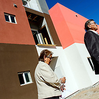 020915  Adron Gardner/Independent<br /> <br /> Navajo Nation President Ben Shelly, right, and his wife Martha walk past the Hooghan Hózhó apartment complex under construction in downtown Gallup Monday.
