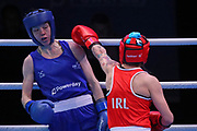 Carly Mcnaul of Ireland (red) and Charley-Sian Davison of Great Britain (bue) competing in the Women's Flyweight preliminaries  during The Road to Tokyo European Olympic Boxing Qualification, Sunday, March 15, 2020, in London, United Kingdom. (Mitchell Gunn-ESPA-Images/Image of Sport)