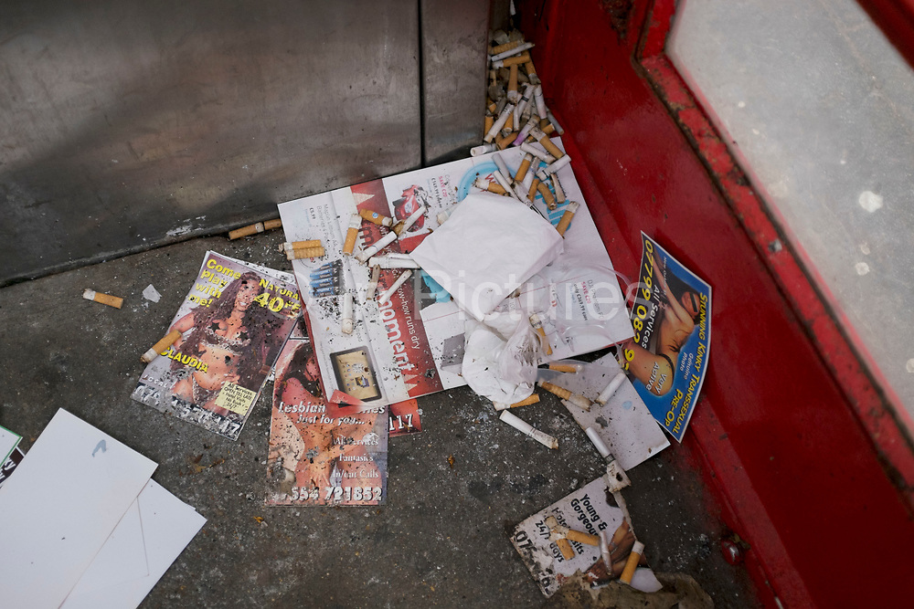 Prostitutes sex cards on a telephone booth floor amongst discarded cigarette ends. 'Tart cards' are cards advertising the services of prostitutes. They are found in many countries, usually in capital cities or red-light districts. The cards originated in the 1960s as handwritten postcards outside prostitutes' flats in places such as Soho, London, where they often contained euphemistic references to sex. Now that phone boxes are rarely used, being used for these cards or as public toilets seems to be their predominant use.