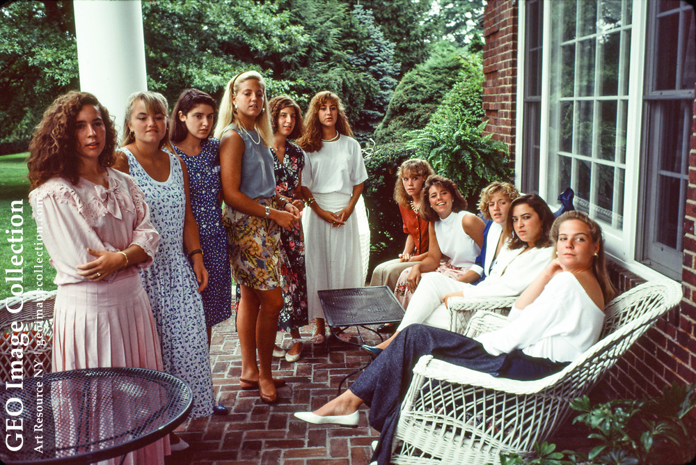 The teenagers are meeting in the home of one of the debutantes. A debutante balls is a social rite for a young lady from an upper class family to be introduced to society at her maturity. Sewickley Heights is an exclusive and affluent suburb of Pittsburgh.