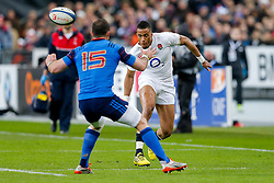 England Winger Anthony Watson chips past France Full Back Scott Spedding - Mandatory byline: Rogan Thomson/JMP - 19/03/2016 - RUGBY UNION - Stade de France - Paris, France - France v England - RBS 6 Nations 2016.