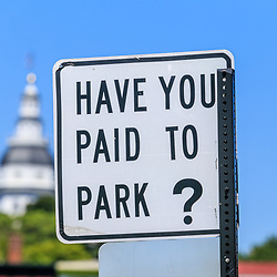 Annapolis, MD / USA - July 9, 2017: The Have Your Paid to Park sign near the docks in the downtown area of Maryland's capital city.