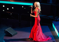 © Licensed to London News Pictures. 07/11/2015.  Royal Albert Hall, London, UK.  Singer Pixie Lott at the annual Festival of Remembrance.  Photo credit : Alison Baskerville/LNP