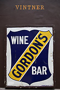 Sign for Gordons Wine Bar on Villiers Street, London, England, United Kingdom. This is the famous basement wine bar loved by many.