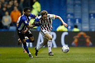Sheffield United Kieran Dowell (8) and Sheffield Wednesday midfielder Rolando Aarons (39)  during the EFL Sky Bet Championship match between Sheffield Wednesday and Sheffield United at Hillsborough, Sheffield, England on 4 March 2019.