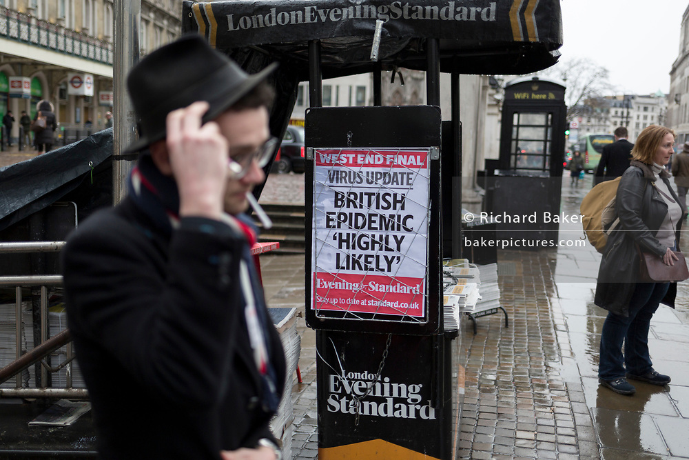 As the Coronovirus pandemic takes hold across the UK, with health authorities reporting cases rising from 25 to 87 in a single day, and resulting in the UK's chief medical officer Prof Chris Whitty announcing that an epidemic in the UK was 'highly likely', Londoners pass-by Evening Standard headlines at Charing Cross in central London, on 4th March 2020, in London, England.