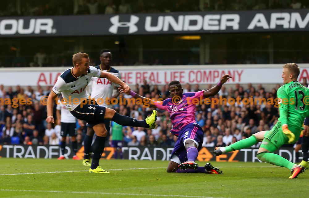 Harry Kane of Tottenham scores past Sunderland's keeper Jordan Pickford during the Premier League match between Tottenham Hotspur and Sunderland AFC at White Hart Lane in London. September 18, 2016.<br /> James Boardman / Telephoto Images<br /> +44 7967 642437