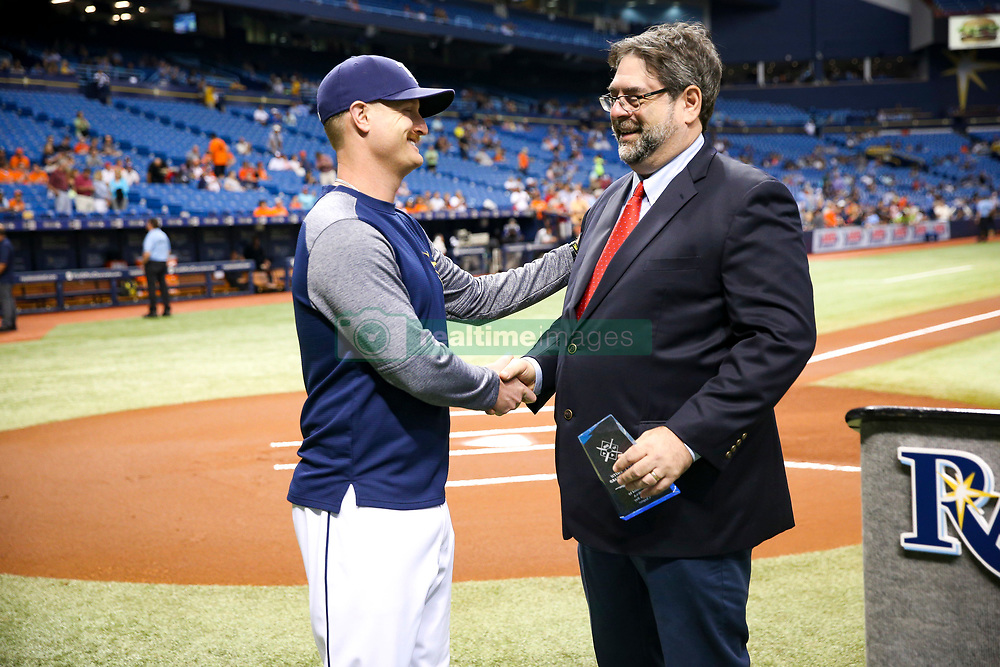 September 29, 2017 - St. Petersburg, Florida, U.S. - WILL VRAGOVIC   |   Times.Tampa Bay Rays starting pitcher Alex Cobb (53) shakes hands with Times reporter and Baseball Writers Association of America Tampa Bay chapter chairman Marc Topkin before being presented with the Paul C. Smith Champion award before of the game between the Baltimore Orioles and the Tampa Bay Rays at Tropicana Field in St. Petersburg, Fla. on Friday, Sept. 29, 2017. (Credit Image: © Will Vragovic/Tampa Bay Times via ZUMA Wire)