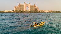 Aerial view of Aquaventure Waterpark gate and yellow boat, Dubai, UAE.