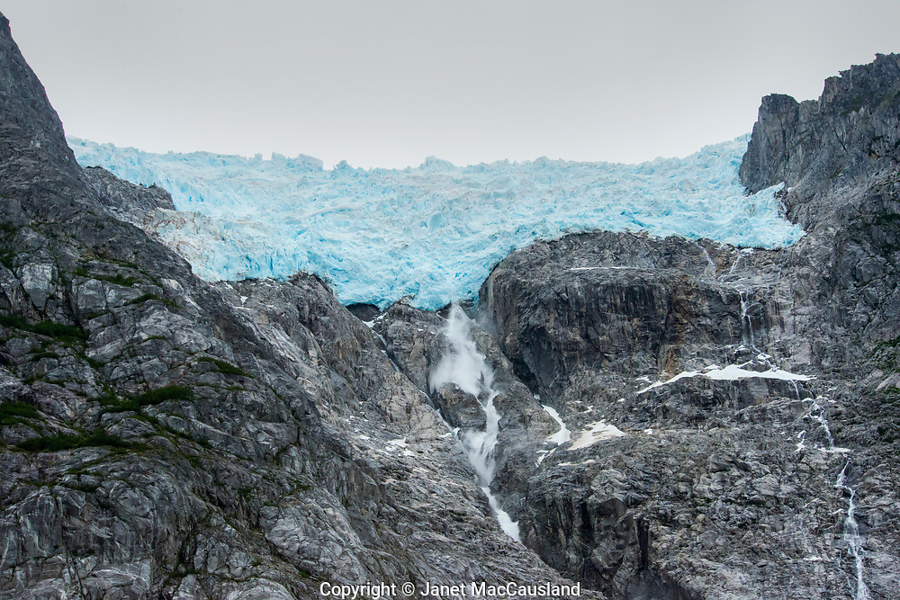 Northwestern Glacier in Alaska is melting and breaking off. Here the water is streaming down into the bay.
