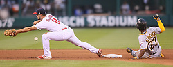 June 25, 2017 - St Louis, MO, USA - St. Louis Cardinals second baseman Paul DeJong tries to keep in contact with the second base bag as he reaches for a throw by shortstop Aledmys Diaz in the fourth inning against the Pittsburgh Pirates on Sunday, June 25, 2017, at Busch Stadium in St. Louis, Mo. The Pirates' Andrew McCutchen reached second then advanced to third on the throwing error by Diaz. The batter, Jordy Mercer, was credited with a single and took second on the error. (Credit Image: © Chris Lee/TNS via ZUMA Wire)