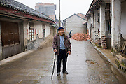Elderly man with a walking stick in Fuli Old Town, Xingping, China