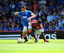 Bristol City's Jay Emmanuel-Thomas battles for the ball with Glasgow Rangers' Lee Wallace - Photo mandatory by-line: Joe Meredith/JMP - Tel: Mobile: 07966 386802 13/07/2013 - SPORT - FOOTBALL - Bristol -  Bristol City v Glasgow Rangers - Pre Season Friendly - Bristol - Ashton Gate Stadium