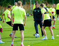 18/08/15<br /> CELTIC TRAINING<br /> LENNOXTOWN<br /> Celtic manager Ronny Deila (3rd from right) gets on the ball during a training drill.