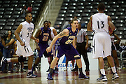 Ryan Gesiakowski (24) of Prairie View A&M defends against Christian Williams (13) of Jackson State during the SWAC semi-finals at the Curtis Culwell Center in Garland on Friday, March 15, 2013. (Cooper Neill/The Dallas Morning News)