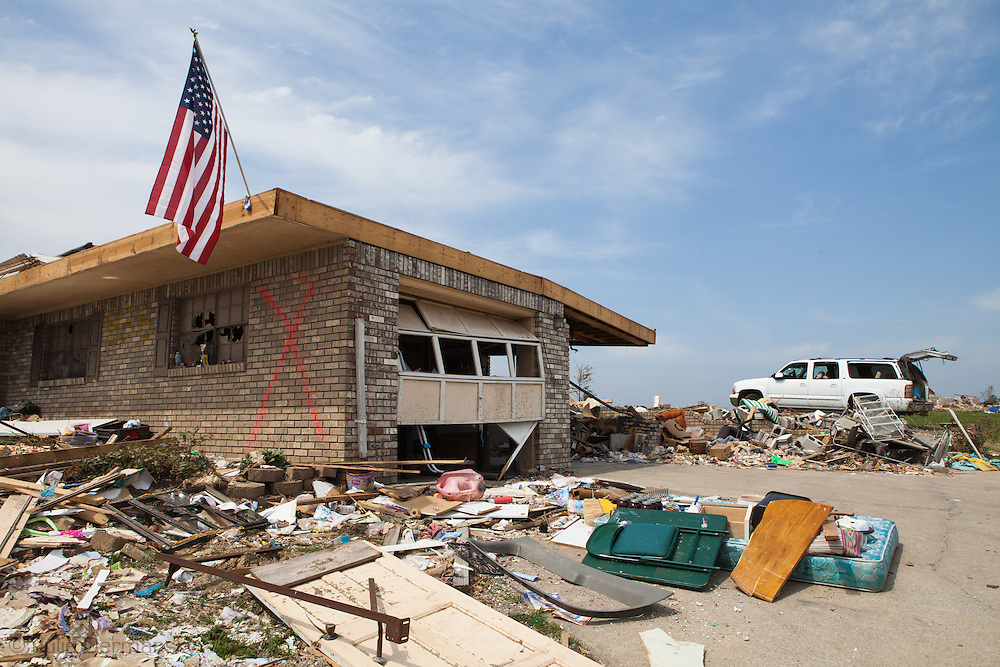 An American flag in front of a home totaled by a tornado in Alabama in Pleasant Grove, a suburb of Birmingham.<br />   Pleasant Grove remains in a state of ruin over two weeks after it was hit by an F-4 ( possibly an F-5) tornado, one of an estimated 300 that struck Alabama and the neighboring states on April 27th .