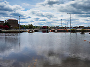 10 MAY 2019 - DAVENPORT, IOWA:  A flooded parking lot near the Mississippi River in Davenport, IA. The Davenport riverfront and downtown flooded on 30 April 2019 when a levee on the Mississippi River failed, allowing the river to flow into Davenport. Parts of downtown are still flooded, nearly two weeks after the levee failed. The river crested at 22.7 feet above flood stage, setting a new record. The previous highest flood stage was 22.63, set in 1993.     PHOTO BY JACK KURTZ
