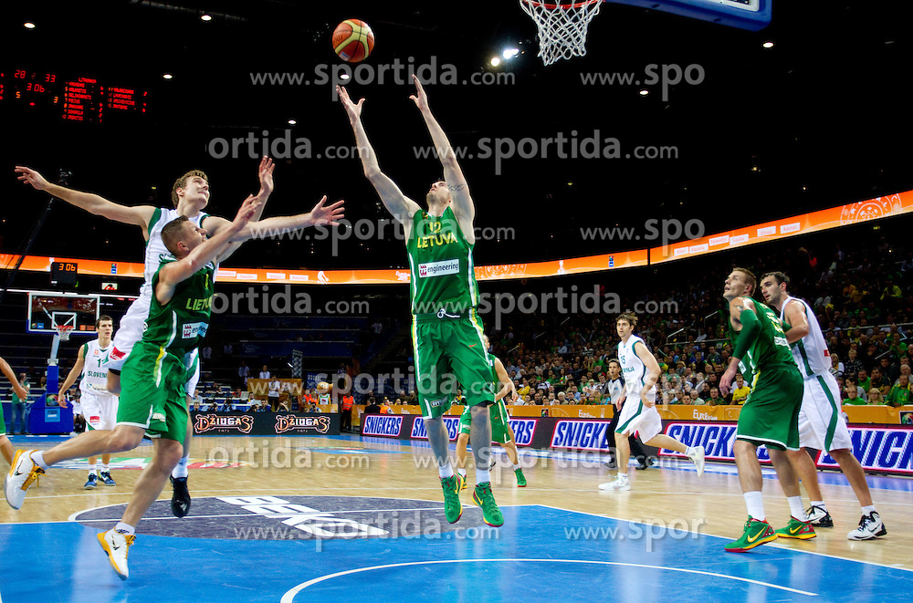 Zoran Dragic of Slovenia vs Rimantas Kaukenas of Lithuania and Ksistof Lavrinovic of Lithuania during basketball game between National basketball teams of Slovenia and Lithuania at of FIBA Europe Eurobasket Lithuania 2011, on September 15, 2011, in Arena Zalgirio, Kaunas, Lithuania. Lithuania defeated Slovenia 80-77.  (Photo by Vid Ponikvar / Sportida)