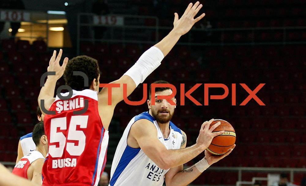 Anadolu Efes's Mukremin Deniz Kilicli (R) during their Turkish Basketball League match Anadolu Efes between Tofas at the Abdi ipekci Arena in Istanbul, Turkey on Tuesday, 24 December, 2013. Photo by TURKPIX