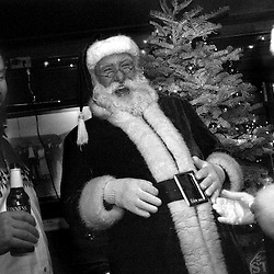 Russell Bissonnette, Santa Claus; his helper Mrs. Claus, Michelle Robelet; and Jim Holsman, left share a laugh at the annual Miramar Beach Restaruant Christmas party on Monday, Dec. 20, 2004.   ..Photo by David Calvert<br />