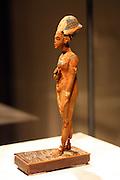 Standing-striding figure of Akhenaten or Tutankhamen New Kingdom, 18th Dynasty around 1340-1330 BC Wood, Gold