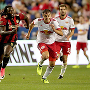 HARRISON, NEW JERSEY- OCTOBER 15: Kenwyne Jones #9 of Atlanta United and Aaron Long #33 of New York Red Bulls challenge for the ball during the New York Red Bulls Vs Atlanta United FC, MLS regular season match at Red Bull Arena, Harrison, New Jersey on October 15, 2017 in Harrison, New Jersey. (Photo by Tim Clayton/Corbis via Getty Images)