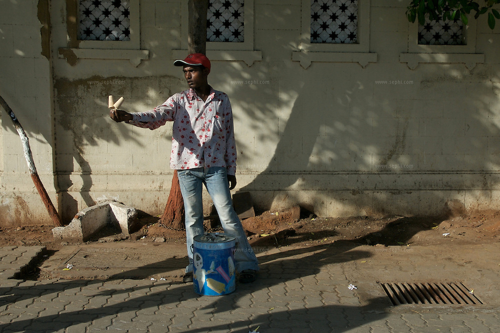 A Hawker selling kulfi (home made ice cream) to tourists at the Gateway of India in Mumbai, June 2007.