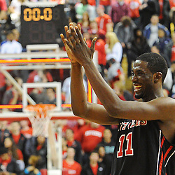 Rutgers Scarlet Knights guard/forward Dane Miller (11) celebrates Rutgers' 67-60 upset victory over #8 UConn in NCAA Big East Basketball action at the Louis Brown Athletic Center in Piscataway, N.J. on Jan 7, 2012.