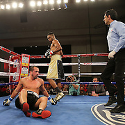 KISSIMMEE, FL - MARCH 06:  Robert Burwell rest on the mat after a punch by Nathaniel Gallimore during the Telemundo Boxeo boxing match at the Kissimmee Civic Center on March 6, 2015 in Kissimmee, Florida. Gallimore won the bout by TKO.  (Photo by Alex Menendez/Getty Images) *** Local Caption *** Nathaniel Gallimore; Robert Burwell