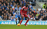 Middlesbrough FC midfielder Albert Adomah and Brighton striker, Rajiv van La Parra (27) during the Sky Bet Championship match between Brighton and Hove Albion and Middlesbrough at the American Express Community Stadium, Brighton and Hove, England on 19 December 2015.