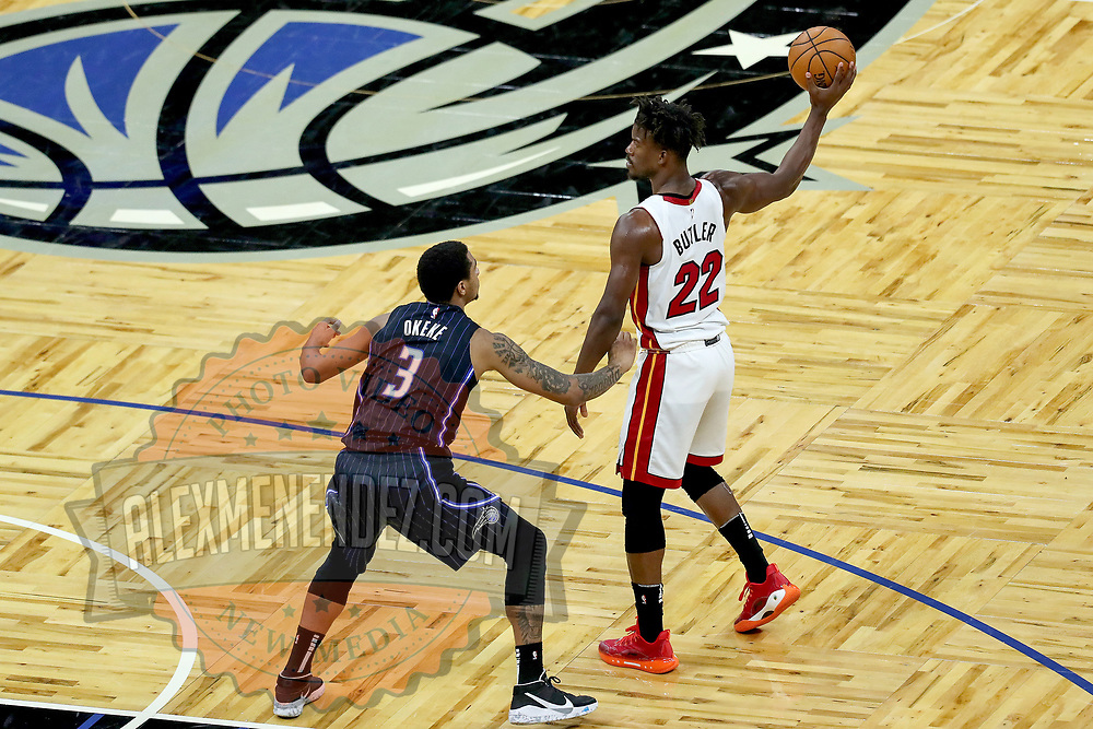 ORLANDO, FL - MARCH 14: Chuma Okeke #3 of the Orlando Magic defends against Jimmy Butler #22 of the Miami Heat during the second half at Amway Center on March 14, 2021 in Orlando, Florida. NOTE TO USER: User expressly acknowledges and agrees that, by downloading and or using this photograph, User is consenting to the terms and conditions of the Getty Images License Agreement. (Photo by Alex Menendez/Getty Images)*** Local Caption *** Chuma Okeke; Jimmy Butler