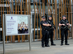 Armed police stand guard at the Scottish Parliament in Edinburgh in the wake of the Manchester Arena bombing and the decision by the Prime Minister to activate Operation Temperer.<br /> <br /> © Dave Johnston/ EEm