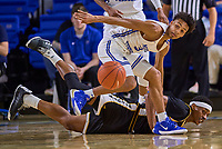 Middle Tennessee Blue Raiders guard Donovan Sims (3) and Southern Miss Golden Eagles forward Leonard Harper-Baker (32) chase a loose ball during the Southern Mississippi Golden Eagles at Middle Tennessee Blue Raiders college basketball game in Murfreesboro, Tennessee, Saturday, March, 7, 2020.<br /> Photo: Harrison McClary/All Tenn Sports