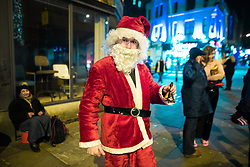 """© Licensed to London News Pictures . 16/12/2017. Manchester, UK. A man dressed as Santa Claus on Withy Grove . Revellers out in Manchester City Centre overnight during """" Mad Friday """" , named for historically being one of the busiest nights of the year for the emergency services in the UK . Photo credit: Joel Goodman/LNP"""