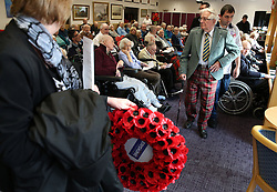Veteran Peter Knowles (right) from the Royal Army Service Corps prepares to lay a wreath on behalf of the Erskine Veterans during a Service of Remembrance on Armistice Day at Erskine Home in Bishopton, Scotland.