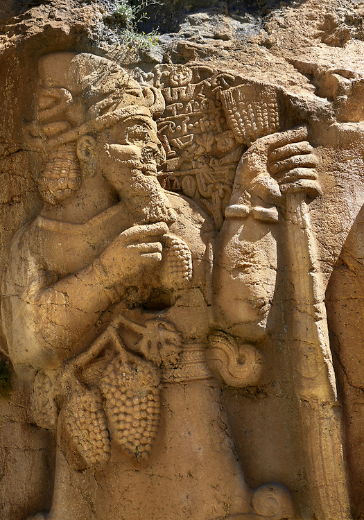 Close up picture of Tarhundas the God of Thunder talking to king Warpalawas. Ivriz Hittite rock relief sculpture monument dedicated to King Warpalawas. Ivriz, Turkey .<br /> <br /> If you prefer to buy from our ALAMY PHOTO LIBRARY  Collection visit : https://www.alamy.com/portfolio/paul-williams-funkystock/ivriz-hittite-monument-turkey.html<br /> <br /> Visit our HITTITE PHOTO COLLECTIONS for more photos to download or buy as wall art prints https://funkystock.photoshelter.com/gallery-collection/The-Hittites-Art-Artefacts-Antiquities-Historic-Sites-Pictures-Images-of/C0000NUBSMhSc3Oo