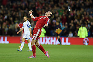 Gareth Bale of Wales celebrates at end of match after the 2-1 win.  Euro 2016 qualifying group B match, Wales v Cyprus at the Cardiff city Stadium <br /> pic by Andrew Orchard,