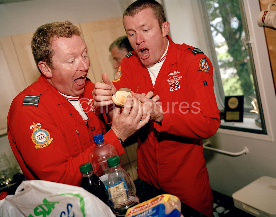 Two pilots of the Red Arrows, Britain's RAF aerobatic team enjoy a moment of release during a stressful display season. In a brief moment of light-hearted banter, the officers joke around in the crew room at their UK base at RAF Scampton. Otherwise, their leaning curve is steep, even for these accomplished fast-jet aviators who had already accumulated 1,500 hours in fighters. By Summer they need every aspect of their 25-minute displays honed to perfection.