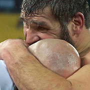 Argentina Captain Felipe Contepomi is embraced by shirtless team mate Martin Scelzo after their sides 13-12 victory during the Argentina V Scotland, Pool B match at the IRB Rugby World Cup tournament. Wellington Regional Stadium, Wellington, New Zealand, 25th September 2011. Photo Tim Clayton...