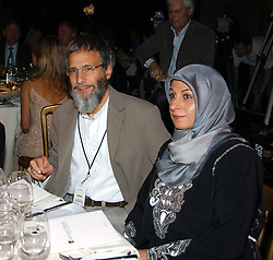 YUSUF ISLAM former known as Cat Stevens with one of his daughters on his right and his wife on his left at the Fortune Forum Dinner held at Old Billingsgate, 1 Old Billingsgate Walk, 16 Lower Thames Street, London EC3R 6DX<br /><br />NON EXCLUSIVE - WORLD RIGHTS