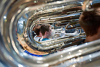 Junior Brandon French is framed by tubas as he plays the baritone sax. The Jackson Memorial Marching Band held a rehearsal on the night of Thursday, September 29, 2016. /Russ DeSantis for the Asbury Park Press / Slug:ASB 1003 Carino Corner