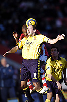 Photo: Olly Greenwood.<br />Charlton Athletic v Aston Villa. The Barclays Premiership. 25/02/2006.<br />Aston Villa's Gavin McCann (R) and Charlton's Darren Bent challenge for the ball.