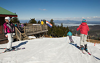 Spring conditions greet skiers heading down Trigger Trail from the top of the Panorama lift at Gunstock on Thursday afternoon.  (Karen Bobotas/for the Laconia Daily Sun)