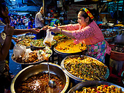 08 AUGUST 2018 - BANGKOK, THAILAND: Venders sell take away meals at Khlong Toei Market in Bangkok. It is the largest market in Thailand.     PHOTO BY JACK KURTZ