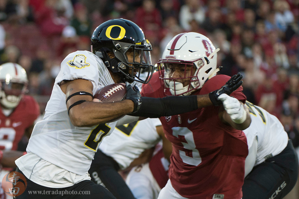 November 14, 2015; Stanford, CA, USA; Oregon Ducks wide receiver Charles Nelson (6) runs with the football against Stanford Cardinal linebacker Noor Davis (3) during the first quarter at Stanford Stadium.