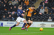 Hull City defender Michael Dawson,Bolton Wanderers midfielder Josh Vela during the Sky Bet Championship match between Hull City and Bolton Wanderers at the KC Stadium, Kingston upon Hull, England on 12 December 2015. Photo by Ian Lyall.