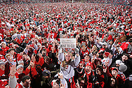 Ohio State fans storm the field to celebrate their 42-39 win over arch rival Michigan at Ohio Stadium in Columbus, Ohio on November 18, 2006. (UPI)