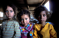 Palestinian refugee kids in a camp in the West Bank, in a feeding program.1978